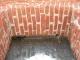Tratto di paramento murario con efflorescenze saline, dopo
