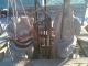 Sequenza fotografica di rimontaggio e consolidamento strutturale degli Angeli sommitali: riposizionamento degli Angeli con l'ausilio di argani elettrici e paranchi a mano